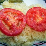 Broiled Parmesan Tomatoes served on Couscous