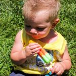 baby eating a bomb pop
