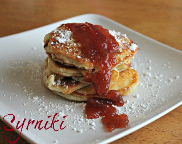 Homemade Syrniki - a delicious Ukranian Pancake topped with jam