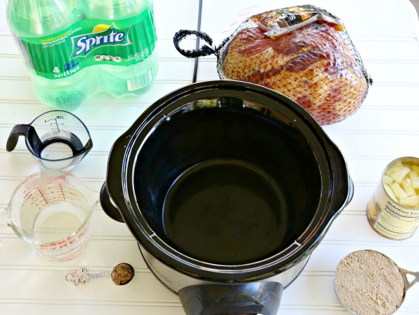 The Best Holiday Ham recipe, cooked in the slow cooker and served with a Yummy Sauce
